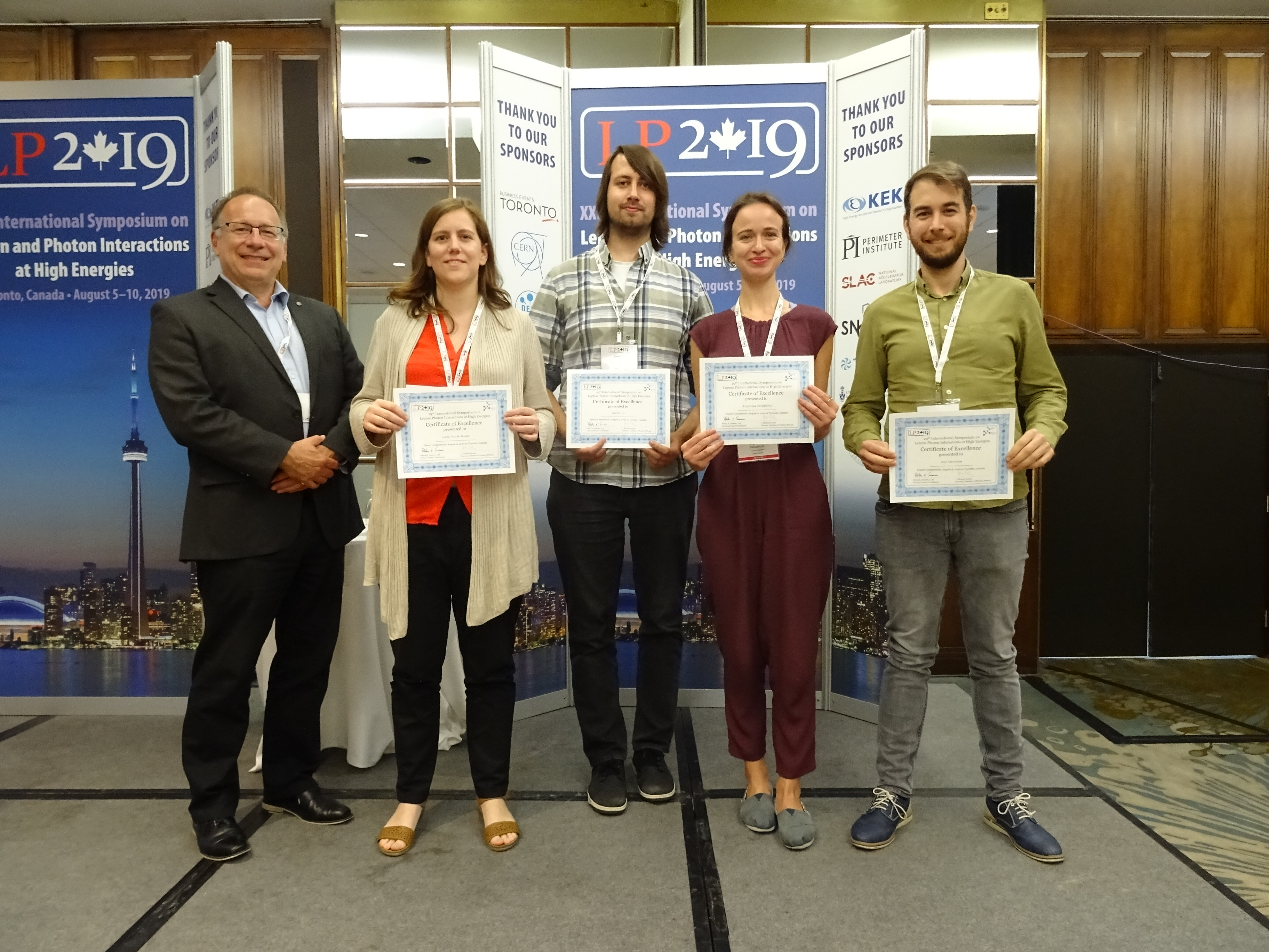 The winners of the Lepton Photon Poster Competition from left-to-right:  Prof. Michael Roney, Director of the Institute for Particle Physics; Dr. Carla Marin Benito, Mr. Robert Les, Ms. Krystsina Petukhova and Mr. Jose Soto-Oton.